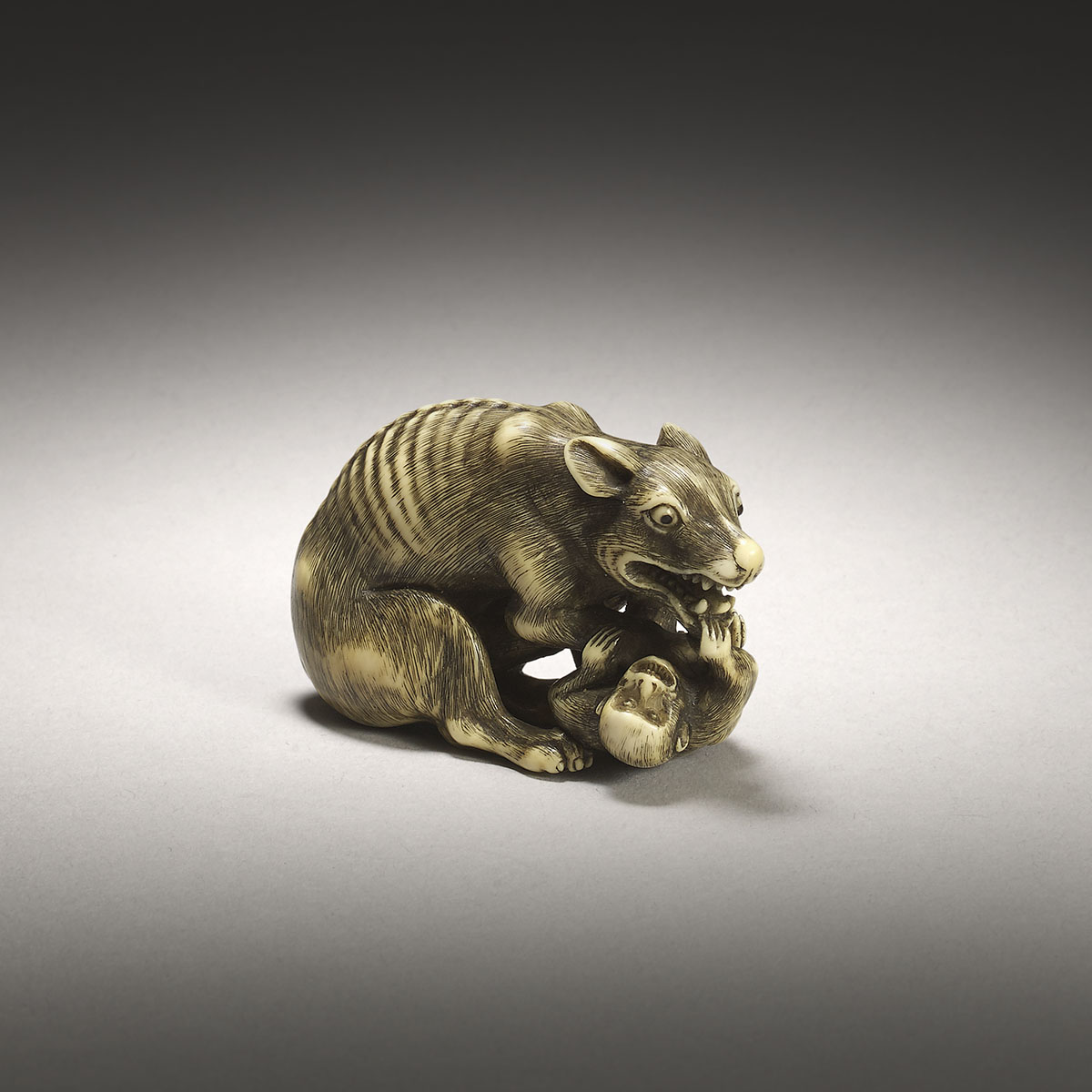 Ivory Netsuke of a Wolf and Monkey
