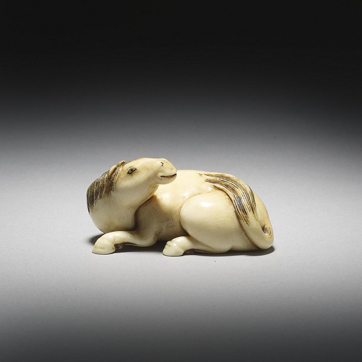 Ivory Netsuke of a Recumbent Stallion_MR2940_v1