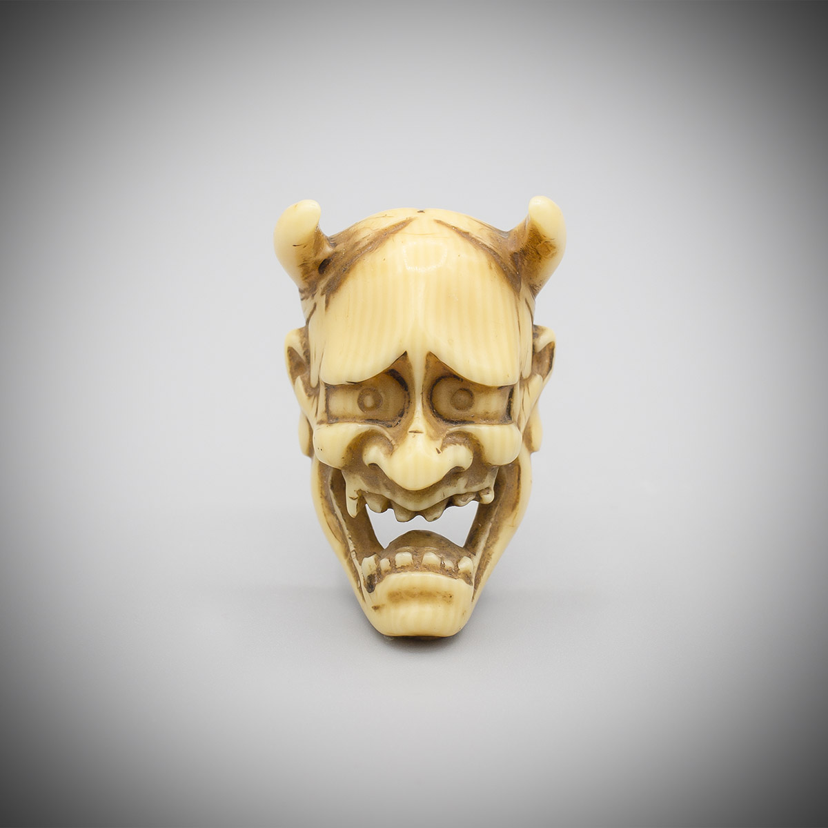 Small ivory mask netsuke of Hannya, MR3398_v.1-2